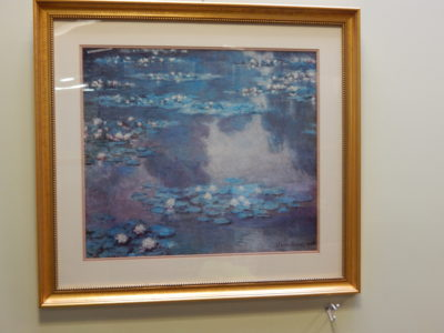 print of lily pads on water by Claude Monet