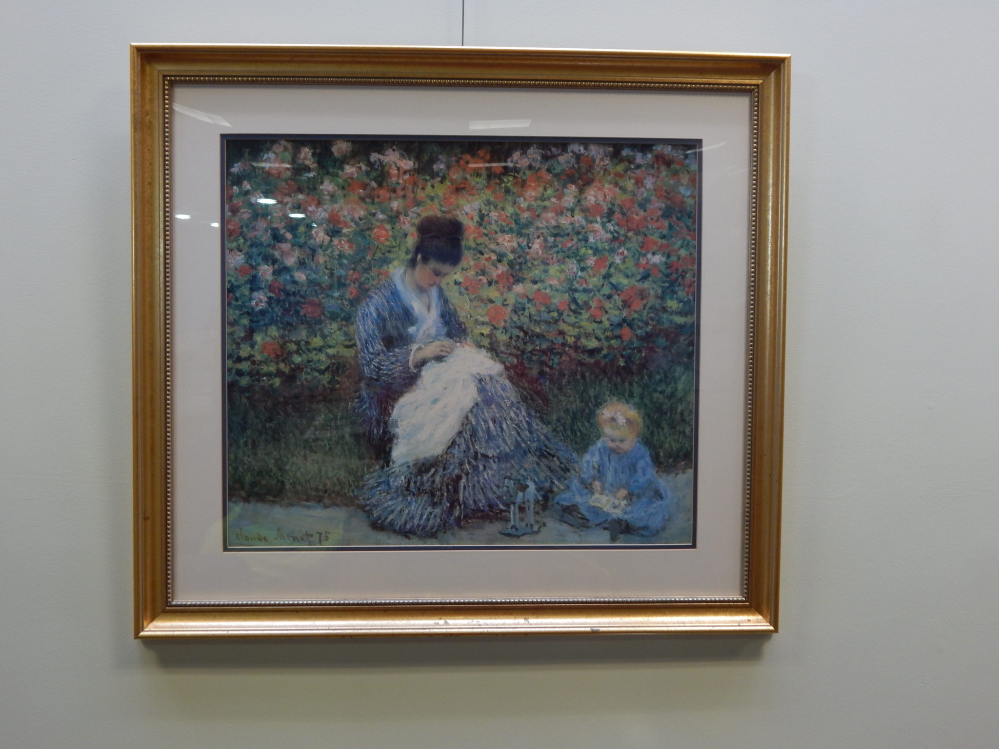 Camille Monet and a Child in the Artist's Garden in Argenteuil, 1875, by Claude Monet, print